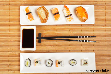 """Close-up of sushi and soy sauce"" by broker"